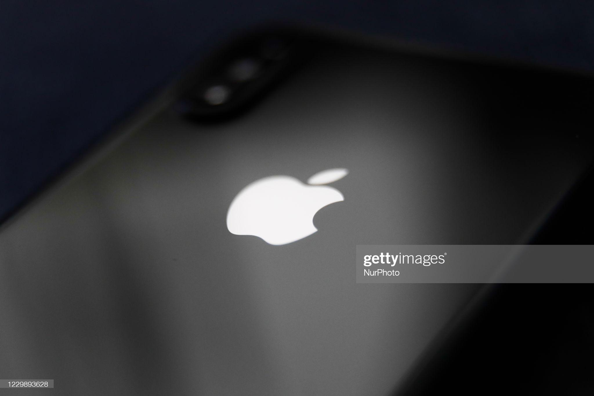 Apple logo is seen on a phone in this illustration photo taken in Poland on December 1, 2020. (Photo by Jakub Porzycki/NurPhoto via Getty Images)