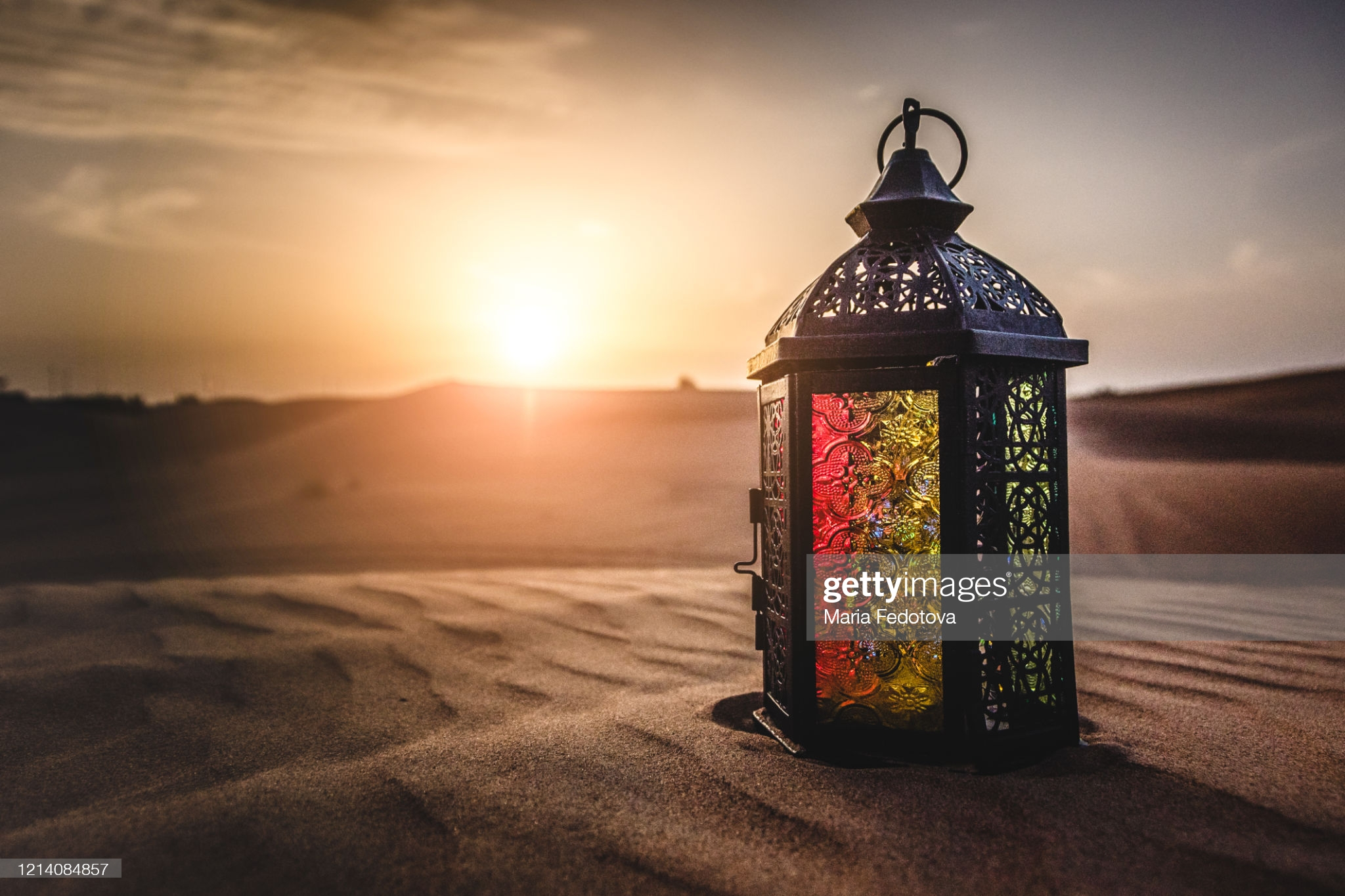Colourful Middle Eastern fanous in desert at sunset. Ramadan object and concept.