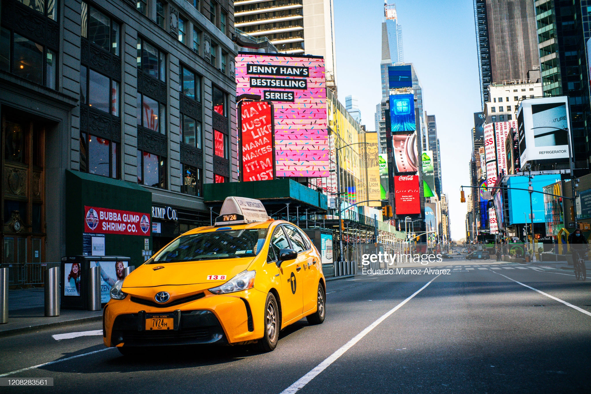 NEW YORK, NY - MARCH 26: A taxi drives down Times Square on March 26, 2020 in New York City. Most cabdrivers are fearful of being exposed to the coronavirus that they prefer to stay home with no way to pay bills, while across the country schools, businesses and places of work have either been shut down or are restricting hours of operation as health officials try to slow the spread of COVID-19. (Photo by Eduardo Munoz Alvarez/Getty Images)