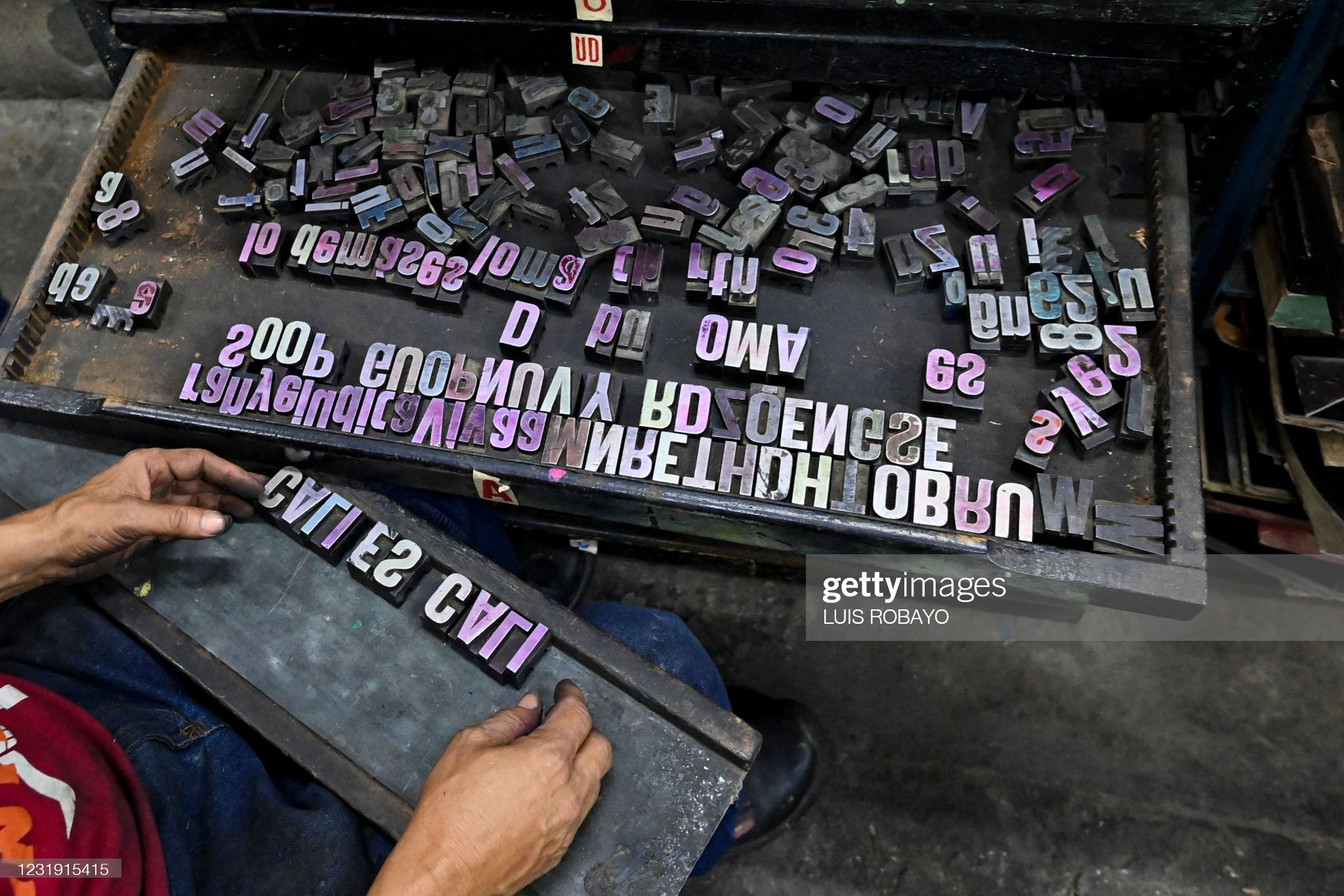 Olmedo Franco, 62, arranges typography letter stamps to be used in a 1890 New Yorks Reliance printing press, at La Linterna printing house in Cali, Colombia, on March 2, 2021. - In the heart of the colonial district of Cali, the La Linterna printing house was slowly dying out until graphic designers and street artists rekindled this beacon of traditional typography. (Photo by Luis ROBAYO / AFP) (Photo by LUIS ROBAYO/AFP via Getty Images)