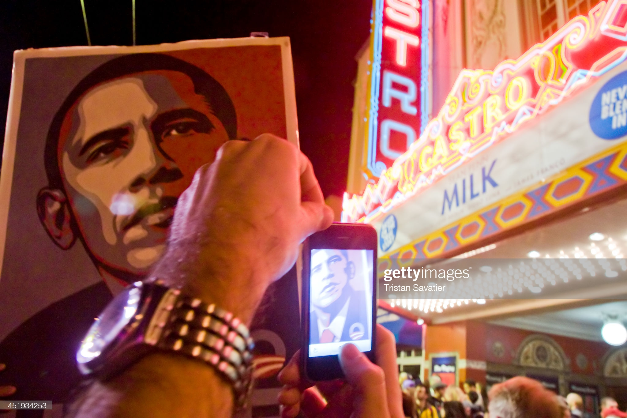 [UNVERIFIED CONTENT] Large Obama poster on picket sign in street crowd celebrating Obama's election in front of the historical Castro theater in San Francisco's Castro district.A spontaneous street party erupted on Castro street on election night.Other keywords: large group of people, crowd, street party, spontaneous, Americans, President Obama's election night, outdoors, celebration, celebrating, joy, happiness, exuberance, demonstration, politics, human interest, democracy, poster, cellphone, iphone, taking photos, photographer, mobile device, mobile phone, landmark, tourist destination, travel destination, night.